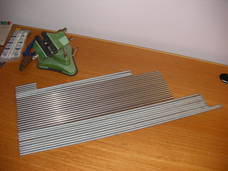 Some cut lengths of steel on a table